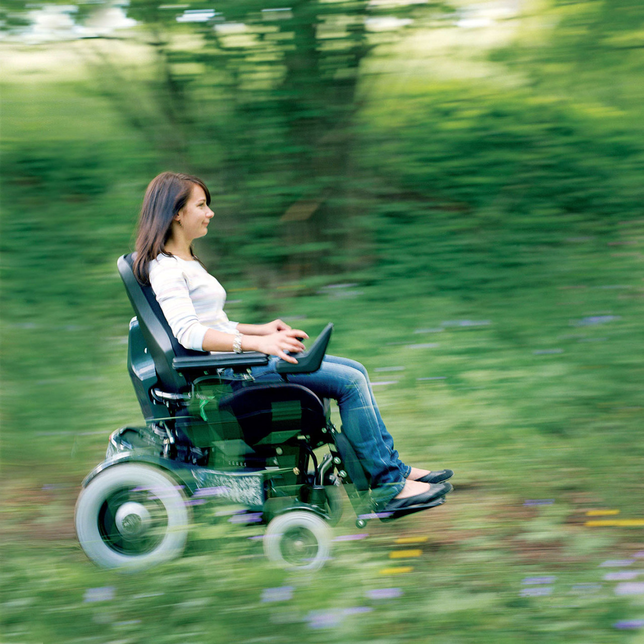 A power wheelchair for rugged outdoor use.