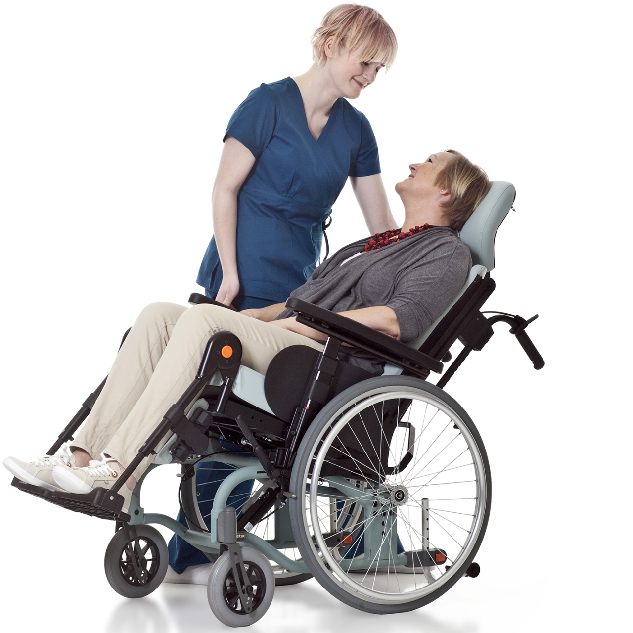 The tilt mechanism can be operated standing beside the chair so that the carer and Prio user have eye contact.